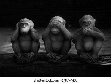 "Three monkeys with Dharma puzzle./Sansaru .""see not, hear not, speak not"".Monochrome"