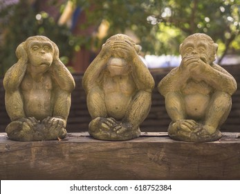 Three monkeys have three actions in temple.