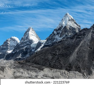 Three mountain peaks Nirekha (6169 m), Kangchung (6062 m), and Chola (6069 m) in the area of Cho Oyu - Gokyo region, Nepal, Himalayas