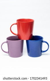 three mug with red, blue and purple color, isolated on white background.