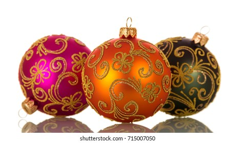 Three multi-colored balls with patterns, isolated on white background