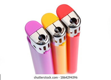 Three multicolored gas lighter on white background isolated. View from above. - Shutterstock ID 1864294396