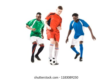 three multiethnic sportsmen playing with soccer ball isolated on white
