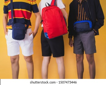 Three musketeers with sport bags