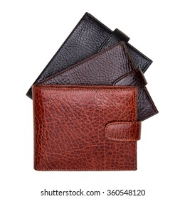 Three natural leather wallets isolated on white background. Expensive man's purses closeup