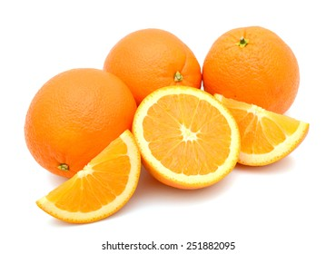 three natural oranges and slices on white background