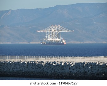 Three new ship-to-shore cranes that were constructed in Morocco were delivered to Tanger med port  Terminal .