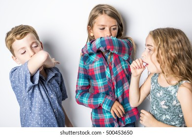 Three nice young child having a cold