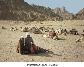 Three nomads in Egyptian desert