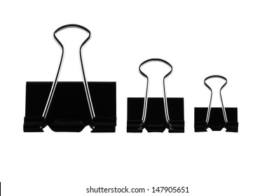 three office paper clips of different sizes on a white background