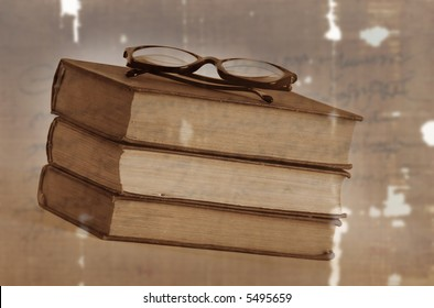 Three old book with eyeglasses