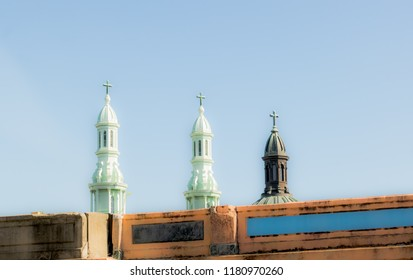 Three old church steeples with cross in old town USA street exploration photography
