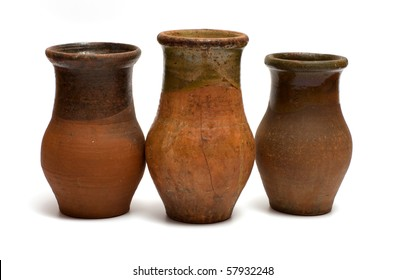 Three of the old earthen bowls isolated on a white background.