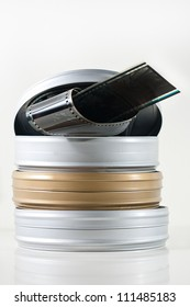 Three old fashioned film tins isolated