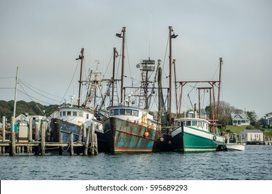 three old fishing boats in a harbor, New England, USA