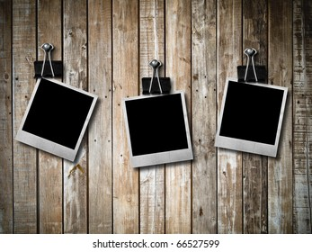 three Old photo frame on Grunge old wood wall texture background