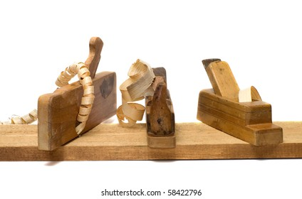 Three old planer on the board isolated on a white background.