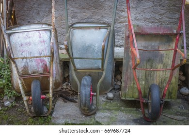 Three old wheelbarrows