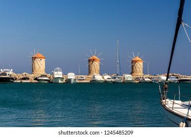 three old windmills in historic port of Mandraki in Rhodes-city