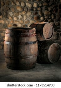 Three old wine barrels in a winery, close up