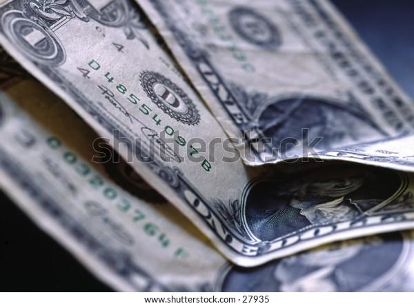 Three on dollar bills