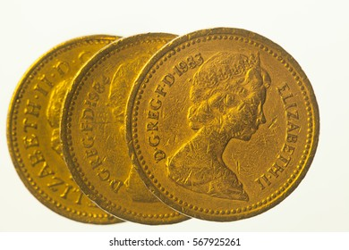 Three one pound coins on the white background
