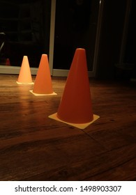 Three orange cones as exercise equipment in fitness gym