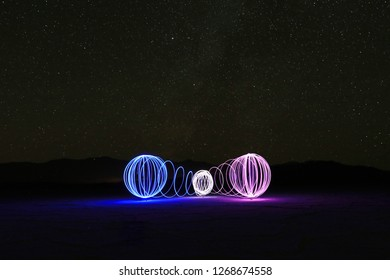 Three Orbs in the Death Valley Salt Flats With the Milky Way Stars