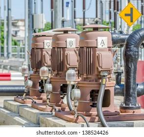 three outdoor pumps