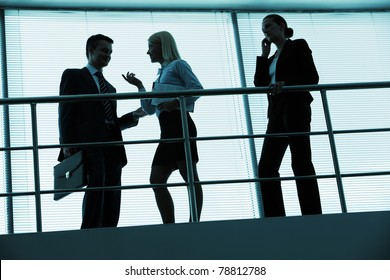 Three outlines of business partners interacting in office