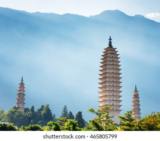 The Three Pagodas of Chongsheng Temple in Dali, Yunnan province, China. Scenic mountains are visible in background. Ancient pagodas are a popular tourist destination of Asia.