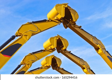 three pairs of excavator buckets joining together