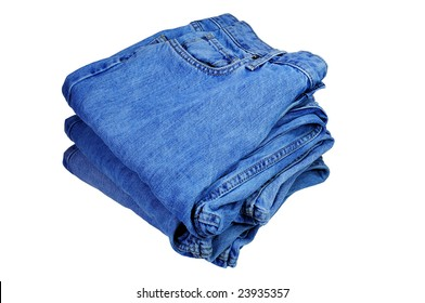 Three pairs of folded jeans