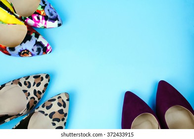 Three pairs of stiletto shoes in different colors and patterns on light blue background.