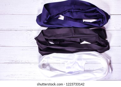 three panties on wooden background