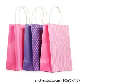 three paper shopping bags isolated on white
