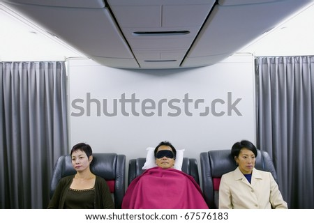 Three passengers on airplane