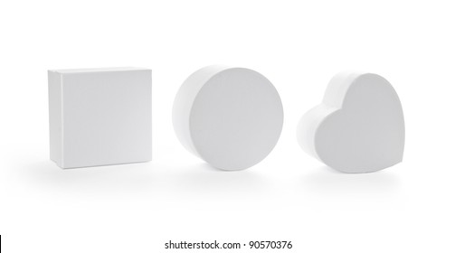 Three pasteboard gift boxes isolated on white background with clipping path. Different shapes.