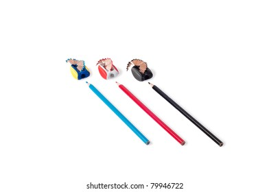 three pencils with pencil sharpeners isolated on white