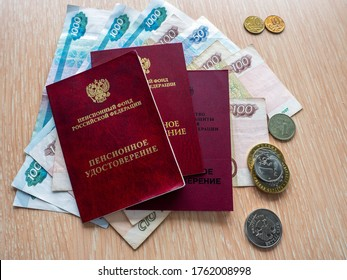 Three pension certificates lie on Russian money. Near metal ruble coins. Receiving and distribution of pensions. - Shutterstock ID 1762008998