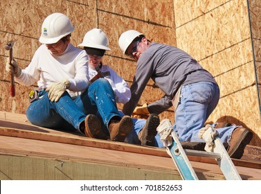 Three people build roof for home for Habitat For Humanity For Humanity. El Rincon, Oakland, Calif on Jan 22, 2011