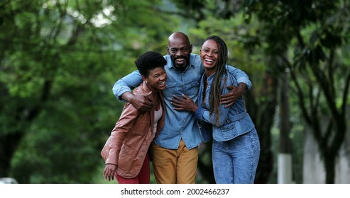 Three people celebrating success uniting group. African ethnicity