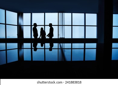 Three people meeting late in office