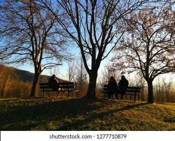 Three People on Park Bench