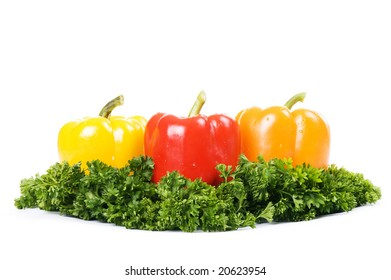 three peppers on green island isolated on white