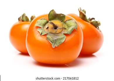 three persimmons on white background