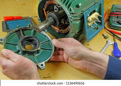 Three phase induction   motor bearing repair – A fitter/technician  removing rotor from stator  prior to changing shaft bearings