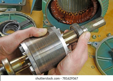 Three phase induction   motor bearing repair – A fitter/technician  checking motor windings resistance readings with a multi meter and  checking for faults on shaft bearings, .