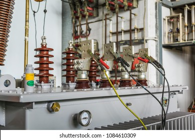 Three phase oil immersed transformer under induced over voltage test, focusing on LV terminals which are connected to testing voltage