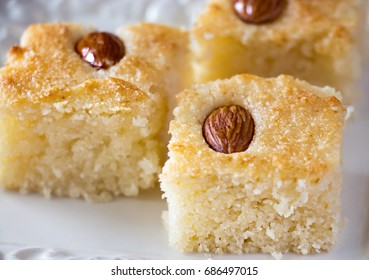 Three pieces Basbousa (namoora) traditional arabic semolina  cake with nut almond and syrup. Copy space